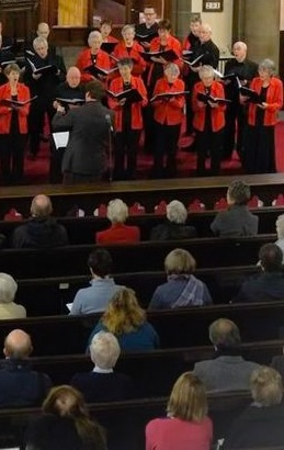 Choir and audience at Jesmond united reformed church, view down from balcony at back of church