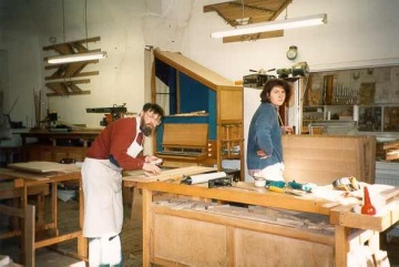 Organ maker and assistant in their workshop