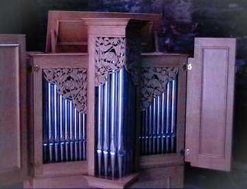 Chamber organ from the front, showing pipes and light oak casing