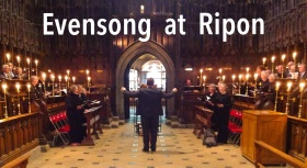 photo of choir in Ripon Cathedral choir stalls with conductor's arms raised
